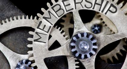 Cogs and gears with the world membership on them