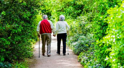 Elderly couple out walking with walking sticks