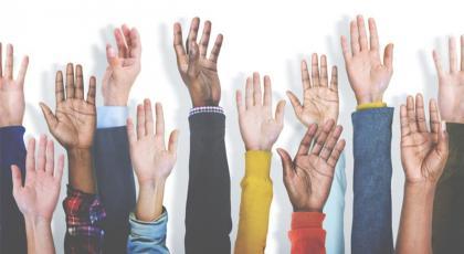 Diverse hands reaching up