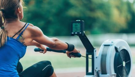 Woman rowing to help strengthen her back