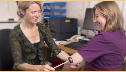 First contact physiotherapist examining a patient