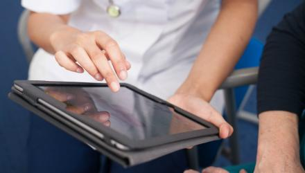 Physiotherapist using a tablet computer