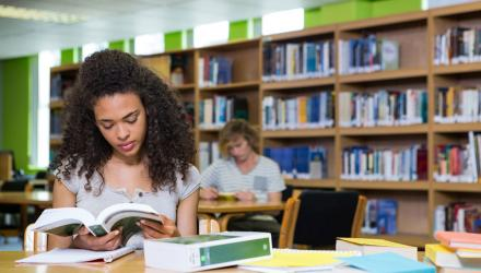 Female student studying in a library