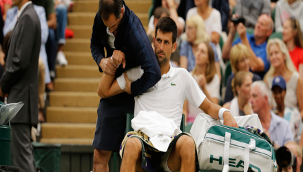 Djokovic with physio on tennis court