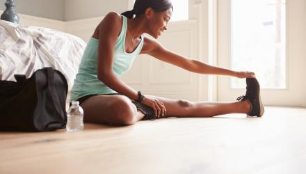 Young woman exercising in her lounge room