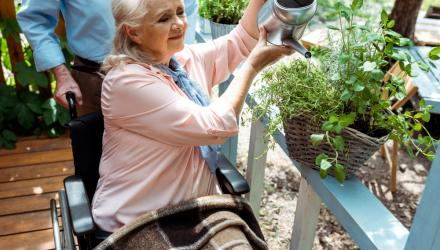 Lady in wheelchair doing some gardening